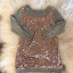 Grey and pink sequined sweater.